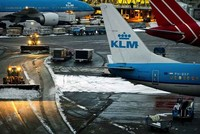 Amsterdam's Schiphol Airport suspended all flights for nearly an hour Thursday and the Dutch national rail service halted trains across the country as a powerful storm battered the Netherlands and...