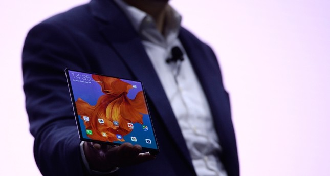 Richard Yu, the CEO of Huawei's consumer products division presents the new HUAWEI Mate X foldable smartphone at the Mobile World Congress (MWC), on February 24, 2019 in Barcelona. (AFP Photo)