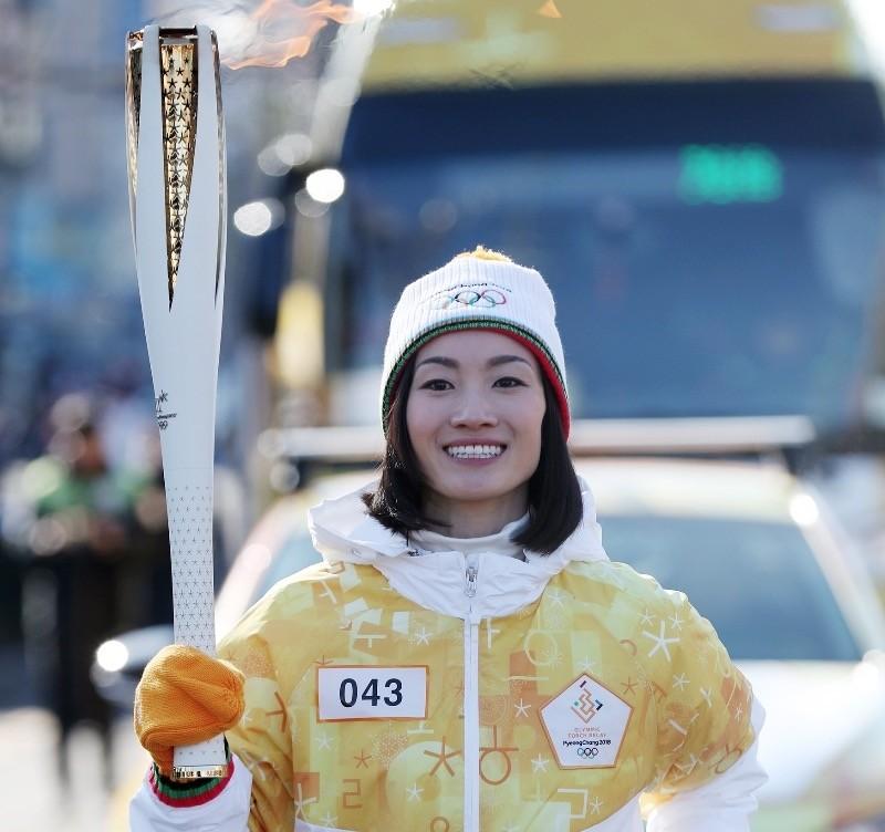 Japanese figure skating gold medalist Shizuka Arakawa carries the torch for the 2018 Pyeongchang Winter Olympics in Incheon, South Korea.
