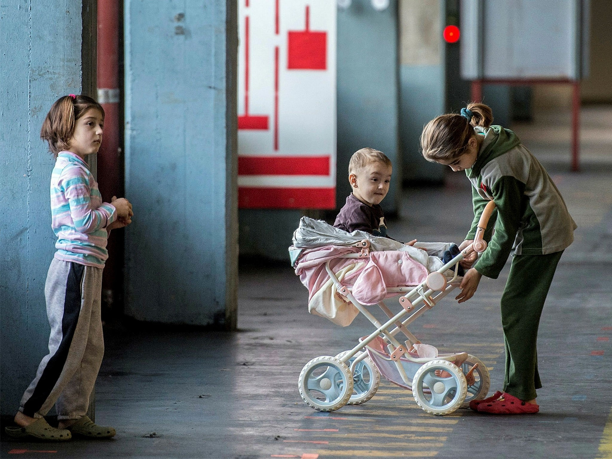 Children play in a building converted into refugee accommodations in Frankfurt, Germany. (FILE Photo)