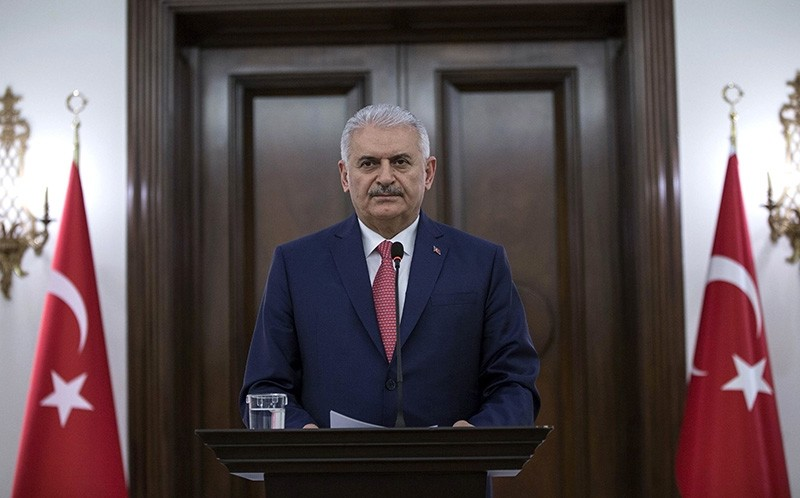 Prime Minister Binali Yu0131ldu0131ru0131m makes a speech regarding the snap presidential and parliamentary election to be held on June 24, 2018 during a press conference at the u00c7ankaya Palace in Ankara, on April 18, 2018. (AFP Photo)
