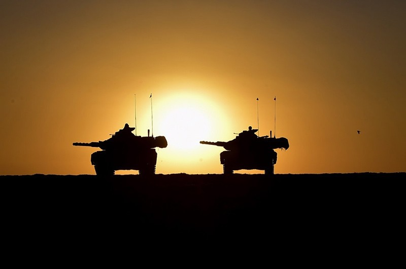 A handout photo made available by the Turkish General Staff press office shows Turkish soldiers with their tanks participate in a military exercise near the Turkish-Iraqi border in the Silopi district, in u015eu0131rnak, Turkey, September 29 2017 (EPA Photo)