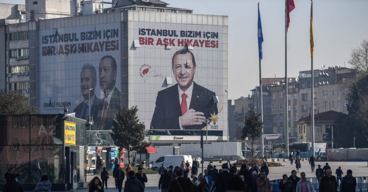 An election poster covers the facade of a building with a picture of President Recep Tayyip Erdou011fan, Istanbul, March 26, 2019.