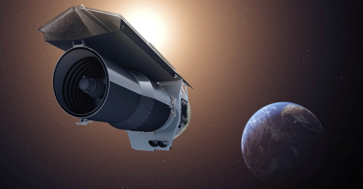 An artist's imprission shows NASA's Spitzer Space Telescope as it begins its ,Beyond, mission.
