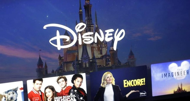 In this Wednesday, Nov. 13, 2019 file photo, a Disney logo forms part of a menu for the Disney Plus movie and entertainment streaming service on a computer screen in Walpole, Mass. (AP Photo)
