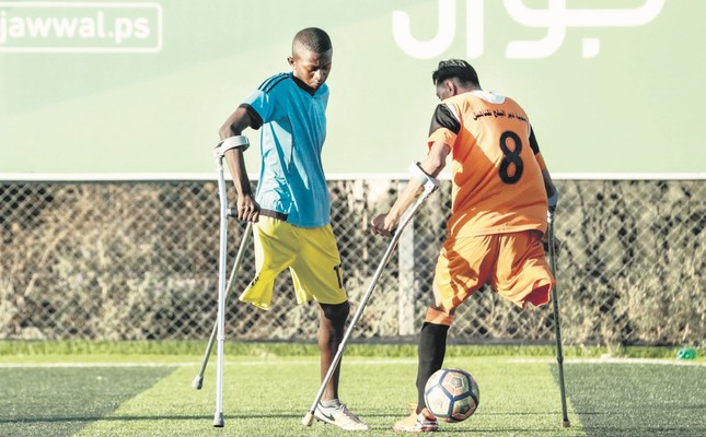 Palestinian amputee soccer players take part in a training session of their team at Municipality Stadium in Deir al-Balah, in the central Gaza Strip, on July 9.