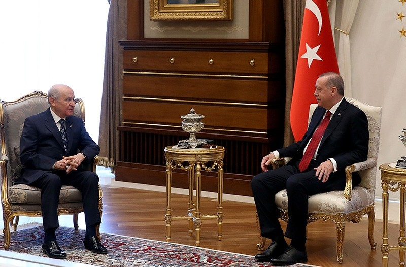 A handout picture taken and released by the Presidential Press Service on April 18, 2018, shows President Recep Tayyip Erdou011fan (R) meeting with MHP Chairman Devlet Bahu00e7eli (L) during their meeting at the Presidential Complex in Ankara (AFP Photo)