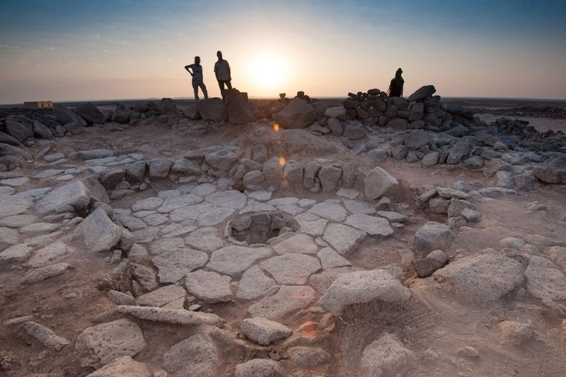 A stone structure at an archeological site containing a fireplace, seen in the middle, where charred remains of 14,500-year-old bread was found in the Black Desert, in northeastern Jordan in this photo provided July 16, 2018. (Reuters Photo)