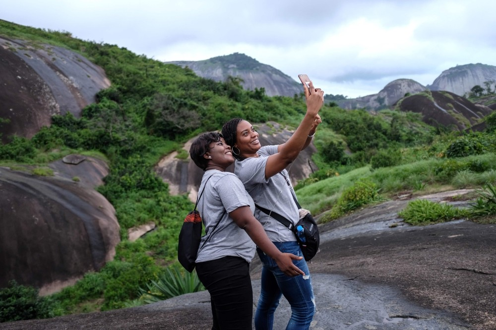 Nigerians take selfies at the Idanre hills.