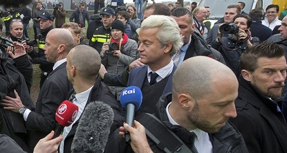pAnti-Islam Dutch MP Geert Wilders and his far-right Freedom Party suspended all public activities Thursday pending a probe after a police agent was arrested for leaking information about him to a...
