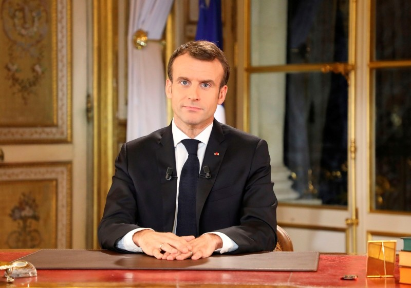French President Emmanuel Macron speaks during a special address to the nation, his first public comments after four weeks of nationwide 'yellow vest' (gilet jaune) protests, on December 10, 2018, at the Elysee Palace, in Paris. (AFP Photo)