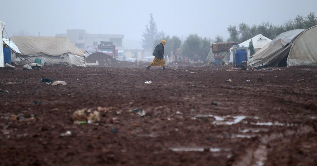 A displaced Syrian woman walks in the Bab al-Salam refugee camp, near the Syrian-Turkish border, northern Aleppo, Syria, Dec. 26, 2016.