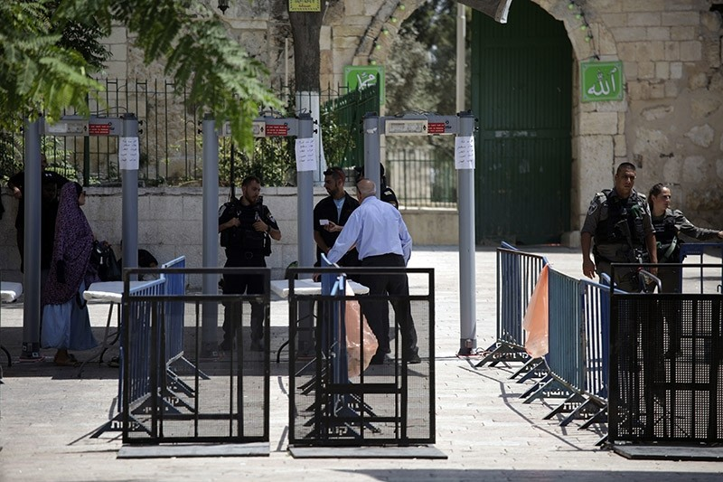A Palestinian man walks past a metal detector at the Al Aqsa Mosque compound in Jerusalem, Tuesday, July 18, 2017. (AP Photo)