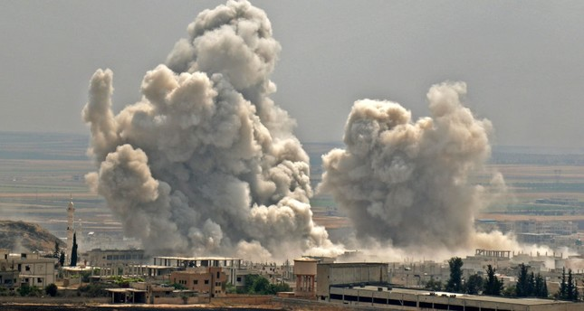 Plumes of smoke rise following reported Syrian regime forces' bombardment on the town of Khan Sheikhun in the southern countryside of the Idlib province, June 7, 2019.
