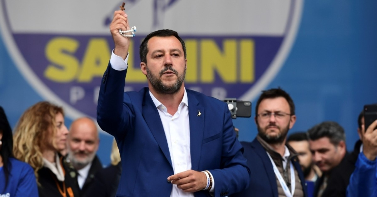 Italian Deputy Prime Minister and Interior Minister Matteo Salvini (C) delivers a speech holding a rosary during a rally of European nationalists ahead of European elections on May 18, 2019, in Milan. (AFP Photo)