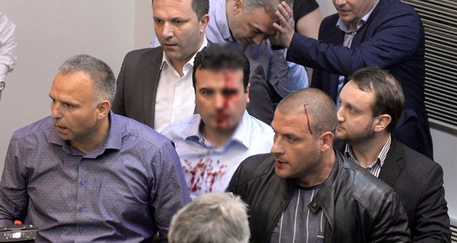The Social Democrat leader Zoran Zaev was left covered in blood after a 200-strong mob stormed parliament. (AA Photo)