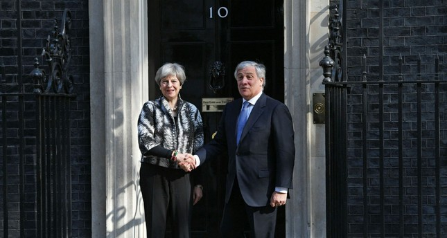 British Prime Minister Theresa May greets the President of the European Parliament Antonio Tajani on the steps of 10 Downing Street in London, Britain, April 20.