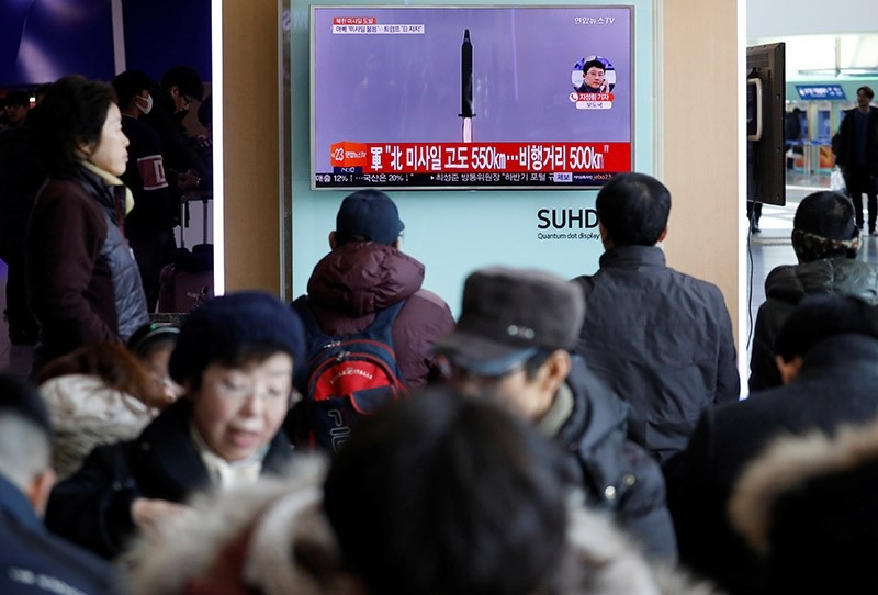Passengers watch a TV screen broadcasting a news report on North Korea firing a ballistic missile into the sea off its east coast, at a railway station in Seoul, South Korea, February 12, 2017. (Reuters Photo)