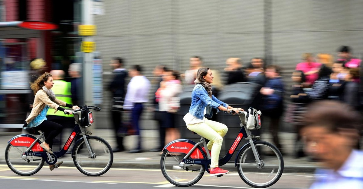 Commuters cycle past a bus queue outside Waterloo Station in London, Britain (Reuters File Photo)