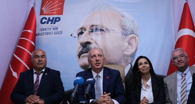 Muharrem Ince C speaks in front a poster of CHP Chairman Kemal Kılıçdaroğlu at party's provincial headquarters in Erzurum, eastern Turkey, on July 4, 2018. AA Photo