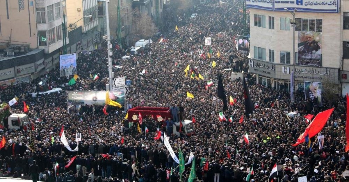Iranian mourners take part in a funeral procession in the capital Tehran for slain military commander Qassem Soleimani, Iraqi paramilitary chief Abu Mahdi al-Muhandis and other victims of a U.S. attack, Jan. 6, 2020. (AFP Photo)