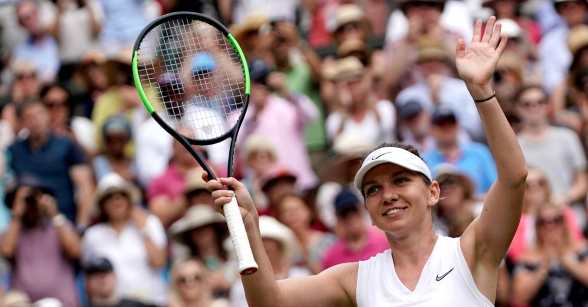 Simona Halep celebrates winning her semi-final match against Elina Svitolina, July 11, 2019.