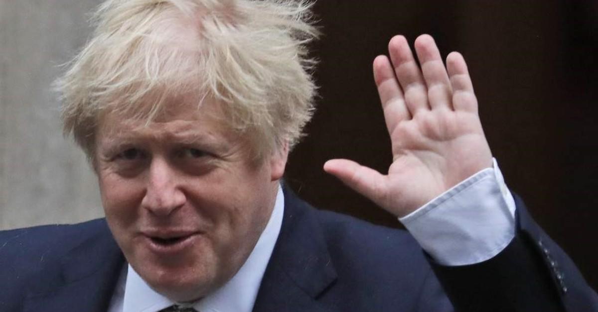 Britain's Prime Minister Boris Johnson waves as he leaves Downing Street, London, Dec. 19, 2019. (AP Photo)