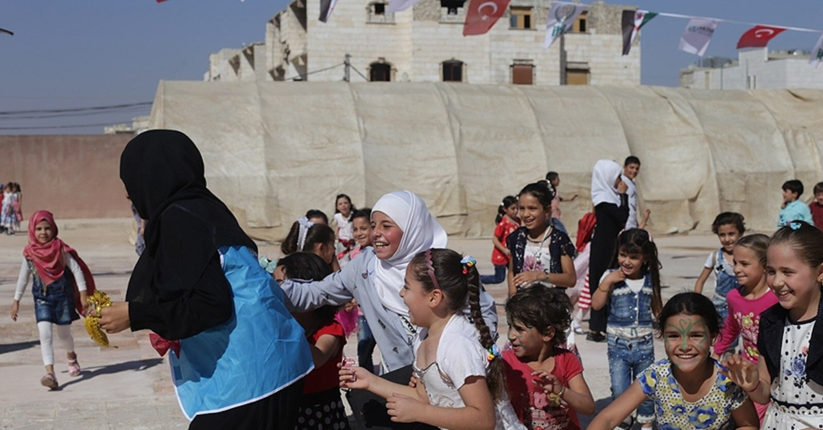 Syrian children participate in various activities during the ,Unlimited Festival, organized by Turkey's International Refugee Rights Association in Al-Bab after it was cleared from terrorists in Operation Euphrates Shield in Sept. 2019. (AA Photo)