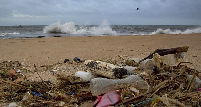 In this Aug. 13, 2015, file photo, a plastic bottle lies among other debris washed ashore on the Indian Ocean beach in Uswetakeiyawa, north of Colombo, Sri Lanka. AP Photo