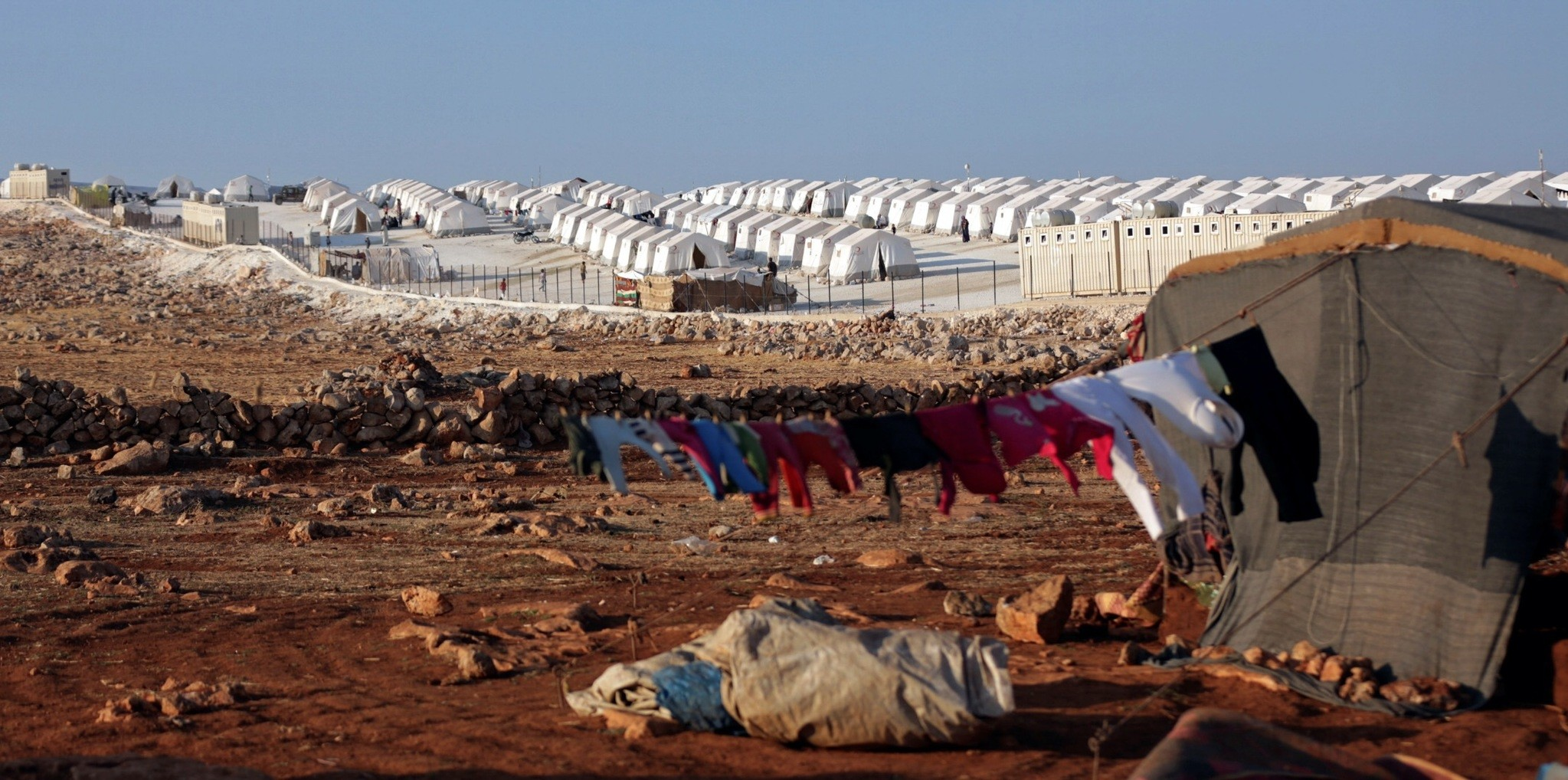 A refugee camp near Atimah village in Idlib province provides shelter to many local civilians, who have left their homes to escape Russian and regime airstrikes; these attacks continue despite warnings from other regional actors, particularly Turkey,