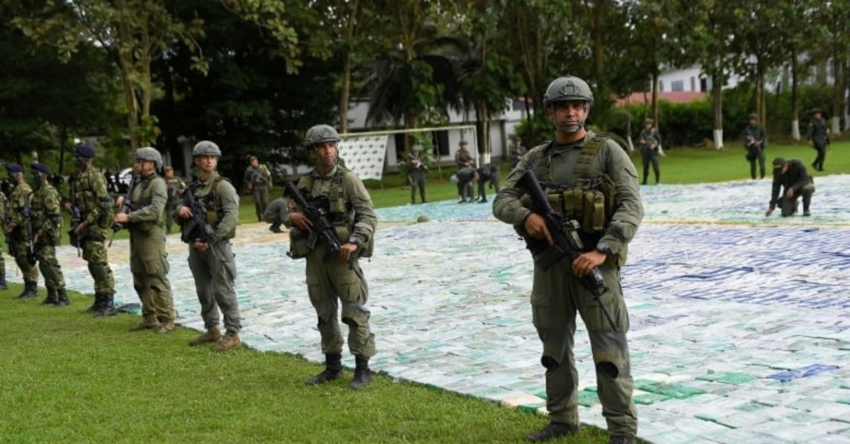 Colombian police and soldiers guard 11 tonnes of seized cocaine in Apartado, Colombia (Reuters File Photo)