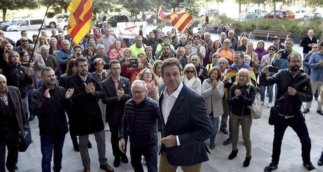 Mayor of Oliana town, Miquel Sala (foreground-C), arrives to testify at a court in Seu d'Urgell, near Lleida, Catalonia, Spain, on 19 September 2017. (EPA Photo)