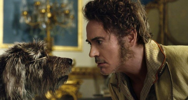 This image released by Universal Pictures shows Dr. John Dolittle, portrayed by Robert Downey Jr., right, with Jip, voiced by Tom Holland, in a scene from Dolittle. AP Photo