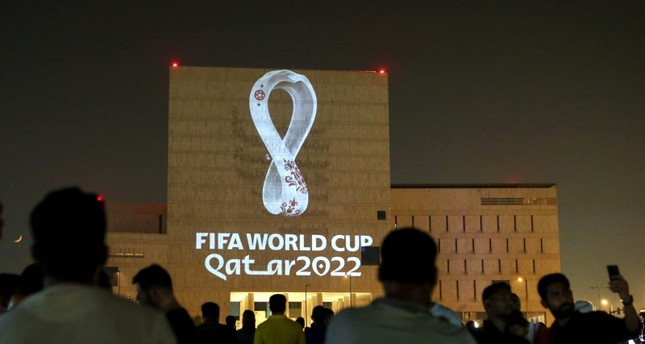 Qataris gather at the capital Doha's traditional Souq Waqif market as the official logo of the FIFA World Cup Qatar 2022 is projected on the front of a building on September 3, 2019. AFP Photo
