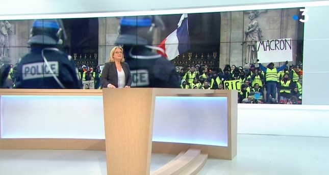 Screengrab of France 3 channel airing doctored image of a protester holding anti-Macron placard.