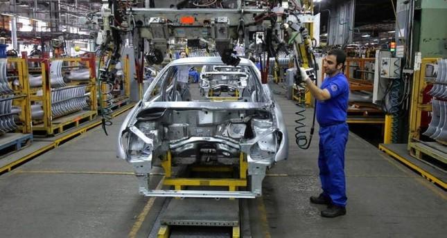 An Iranian worker assembles a car at the Iran Khodro automobile manufacturing plant, just outside Tehran, Iran, Jan. 18, 2014. (AP Photo)