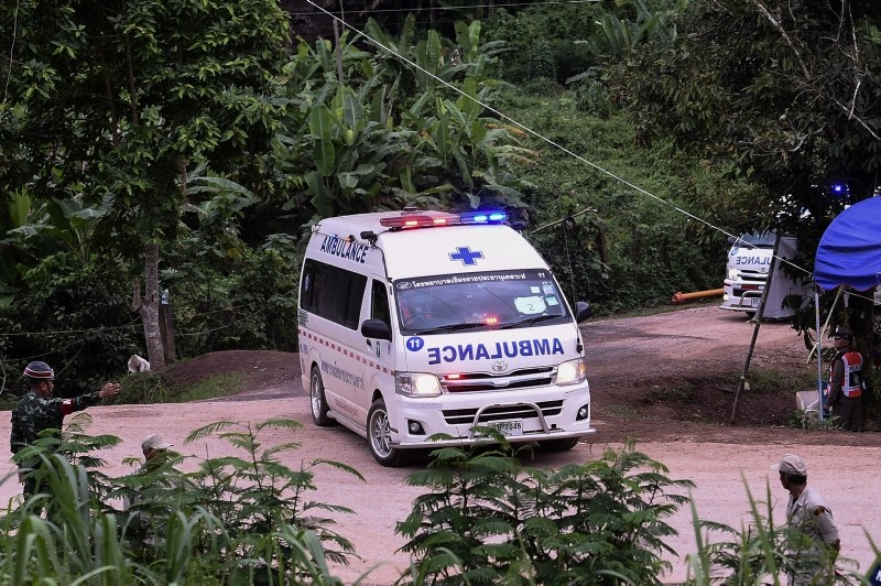 Ambulances leave the Tham Luang cave area as operations continue for those still trapped inside the cave in Khun Nam Nang Non Forest Park in the Mae Sai district of Chiang Rai province on July 10, 2018. (AFP Photo)