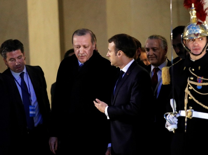 President Erdou011fan (L) leaves after a meeting with French President Macron (R) at the Elysee Palace, Paris, Jan. 5. (AP Photo)