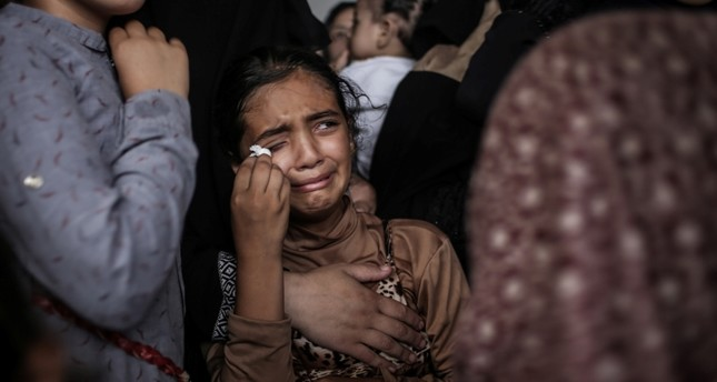 A relative of twelve years old Majdi Al Satari mourns during his funeral in Rafah refugee camp in the southern Gaza Strip, 28 July 2018. EPA Photo