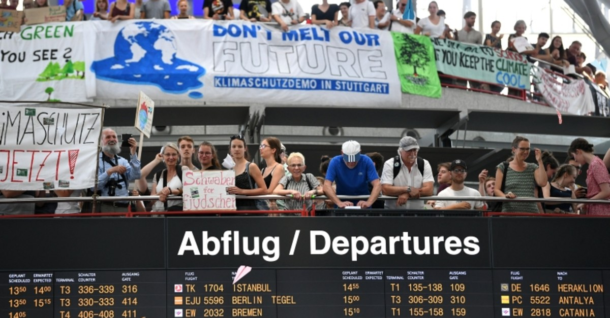 People throw paper planes during a ,Fridays for Future, protest, claiming for urgent measures to combat climate change, at Stuttgart airport, Germany July 26, 2019 (Reuters Photo)
