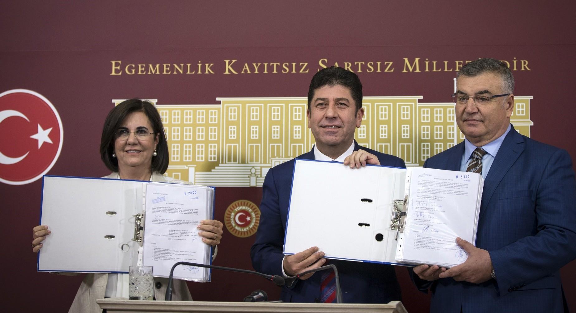 CHP Party Assembly member Gaye Usluer (L) with CHP Bilecik province deputy, Yau015far Tu00fczu00fcn (C) and Ku0131rklarelu0131 Mayor Mehmet Kesimou011flu showing signatures collected for convention.