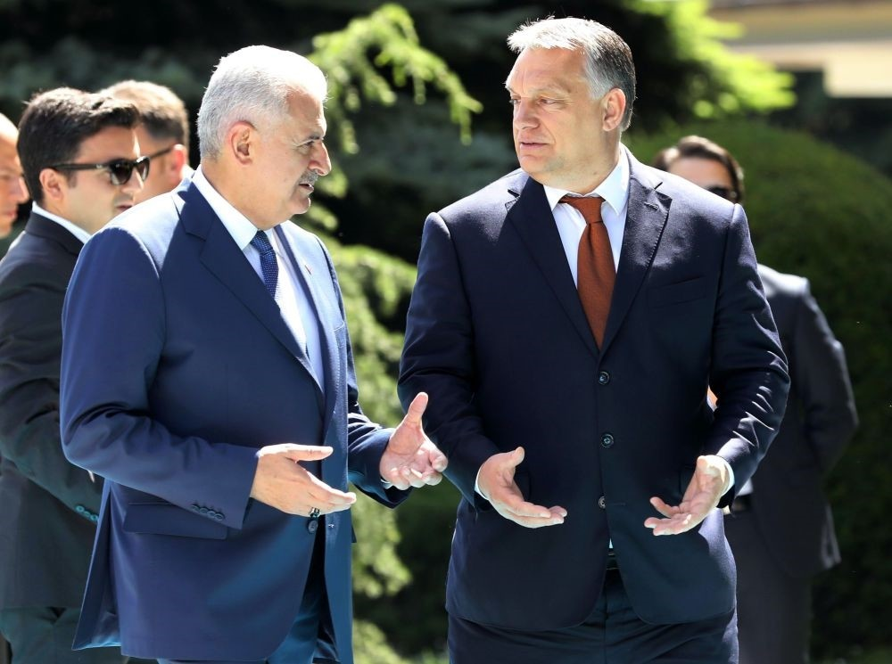 Prime Minister Binali Yu0131ldu0131ru0131m (L) gestures as he walks with Hungary's Prime Minister Viktor Orban upon his arrival at u00c7ankaya Prime Ministerial Office in Ankara on Friday.