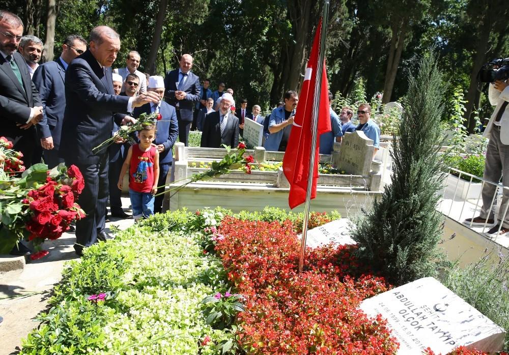 President Erdou011fan visits graves of his close friend Erol Olu00e7ok and his son Abdullah Tayyip who were killed by putschists while resisting them.