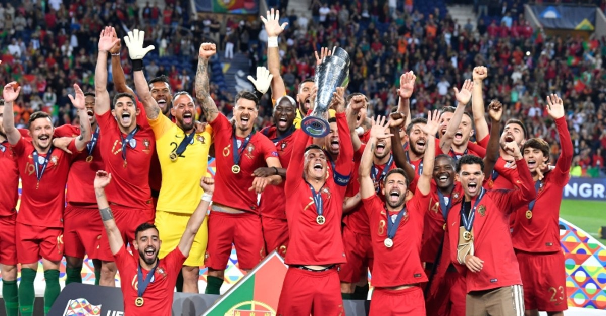Portugal's Cristiano Ronaldo lifts up the trophy as he celebrates with players after winning the UEFA Nations League final match between Portugal and Netherlands at the Dragao stadium in Porto, Portugal, June 9, 2019. Portugal won 1-0. (AP Photo)