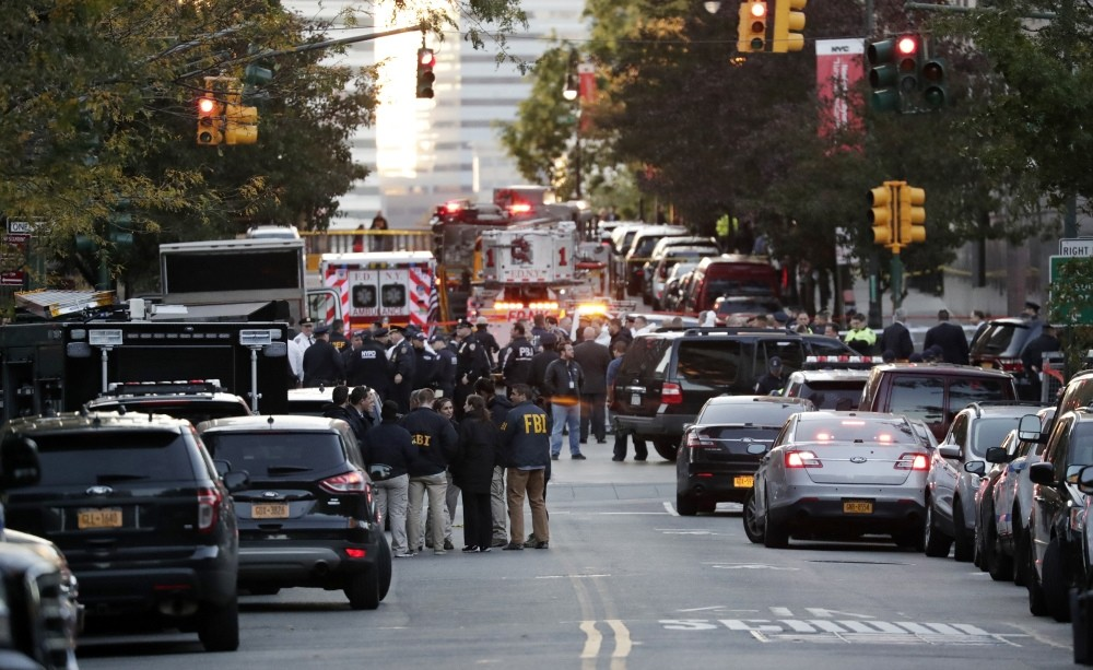 FBI and New York City EMTs at the scene of the terrorist attack by a man who reportedly drove a pickup truck along a bike lane in downtown New York City, killing 8 people, Oct. 31.