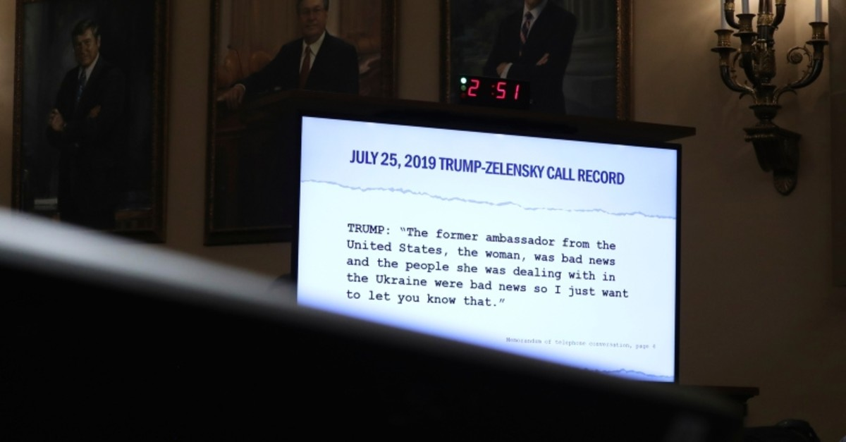 A quote is displayed on a monitor as former U.S. Ambassador to Ukraine Marie Yovanovitch testifies before the House Intelligence Committee on Capitol Hill in Washington, Friday, Nov. 15, 2019 (AP Photo)