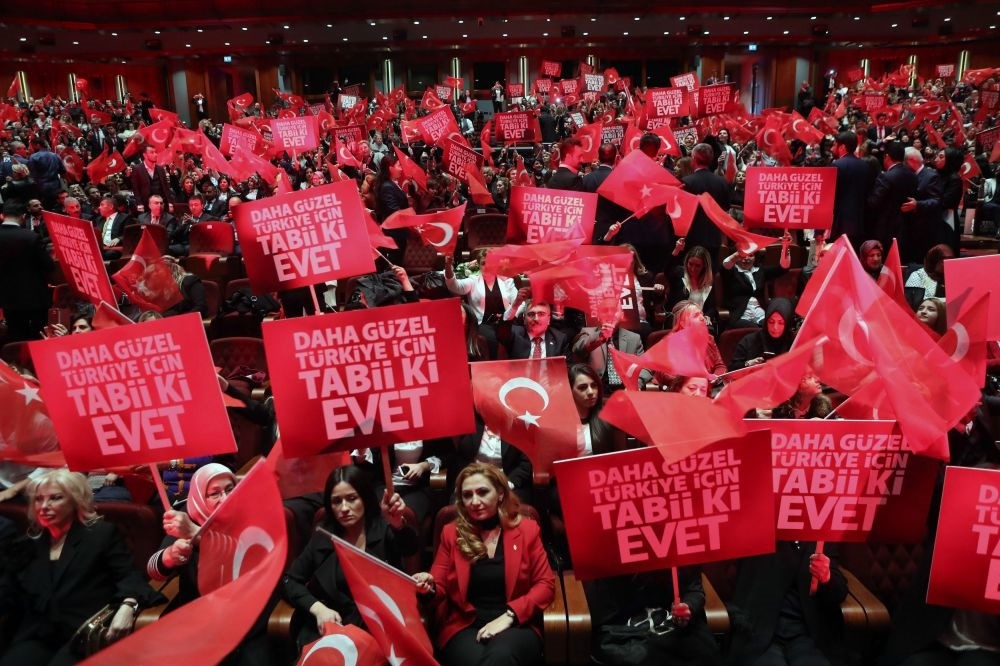 People holding banners and waving flags during a rally held by President Erdou011fan as part of the campaign ahead the constitutioal referendum in April 16, Ankara, March 29.