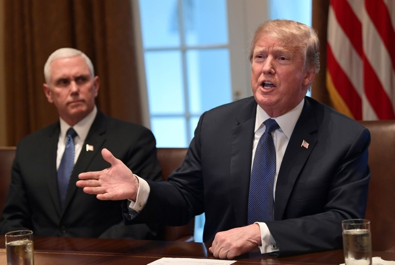 President Donald Trump, right, sitting next to Vice President Mike Pence, left, speaks in the Cabinet Room of the White House in Washington, Monday, April 9, 2018. (AP Photo)