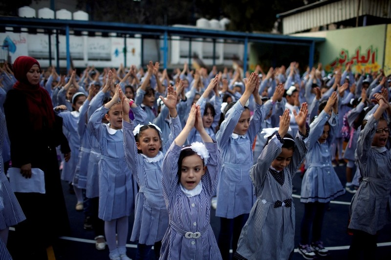 Palestinian schoolgirls participate in the morning exercise at an UNRWA-run school, on the first day of a new school year, in Gaza City August 29, 2018. (Reuters File Photo)