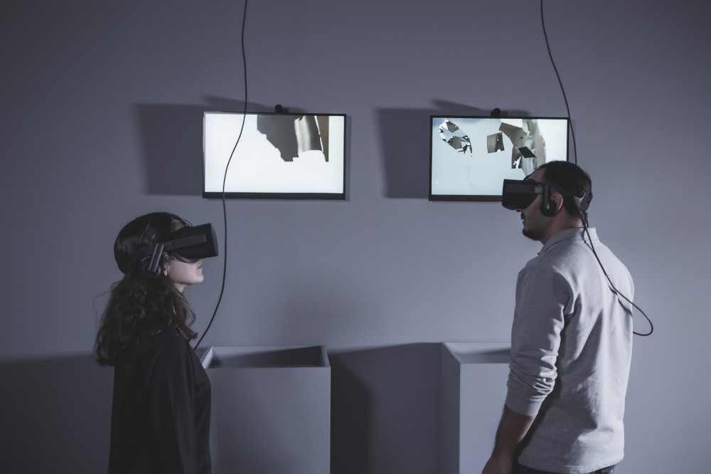 Rachel Rosin u201cI Came And Went As A Ghost Hand, Cycle I,u201d 2015  2 virtual reality headsets, monitor and painting, 2u201930u201d